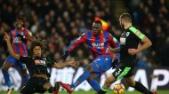 Crystal Palace's Christian Benteke, center, and Bournemouth's Nathan Ake battle for the ball during their English ...