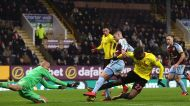 Watford goalkeeper Heurelho Gomes , left, claims the ball at the feet of Burnley's Johann Berg Gudmundsson , during the ...