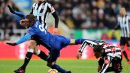 Leicester City's Jamie Vardy, left, and Newcastle United's DeAndre Yedlin battle for the ball during their English ...