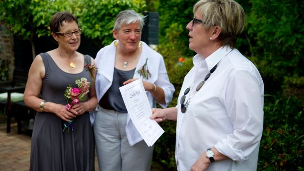 Anne-Marie Delahunt, centre, with her partner Margaret Penrose Clark and marriage celebrant Judy Aulich at their wedding ...