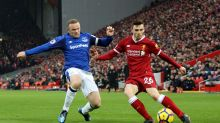 Everton's Wayne Rooney, left, and Liverpool's Andrew Robertson battle for the ball during their English Premier League ...