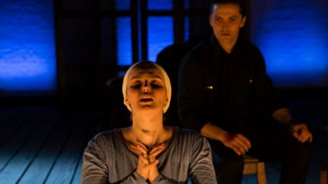 Claudia Ware as Isabella prays before Gabriel Fancourt as Angelo.