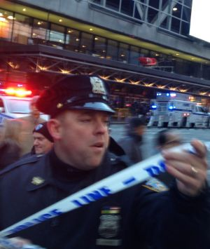 Police respond to a report of an explosion near Times Square on Monday in New York.