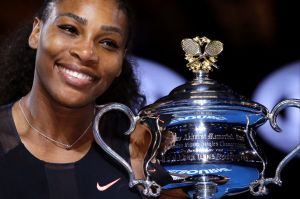 Serena Williams holds her trophy after defeating her sister Venus at the 2017 Australian Open.