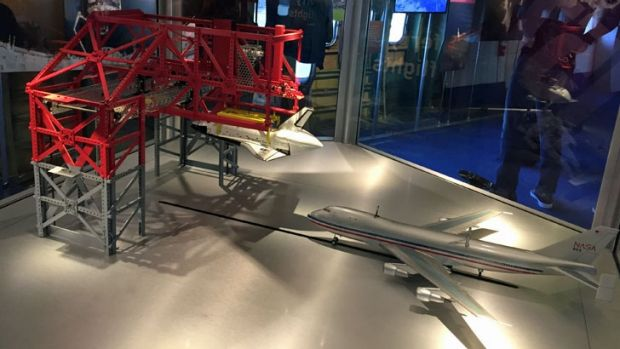 A tour through the 747 tells the history of the Shuttle program, with a model revealing how the Shuttle is mounted on ...