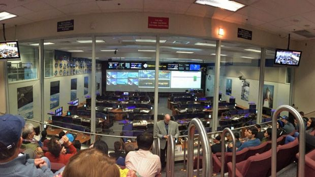 Mission Control in Johnson Space Center, with a live feed from the International Space Station.
