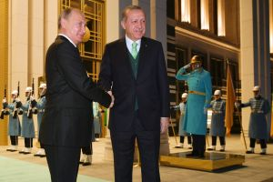 Vladimir Putin, left, shakes hands with Recep Tayyip Erdogan prior to their meeting at the Presidential Palace in ...