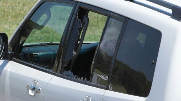 A side window of the vehicle was smashed during the arrest.