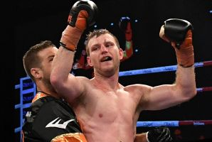 Hornet stings: Jeff Horn celebrates after successfully defending his WBO world welterweight champion title against UK ...