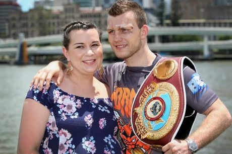 Next stop, Las Vegas: Jeff Horn is joined by wife Jo at a press conference after defending his WBO welterweight title belt.