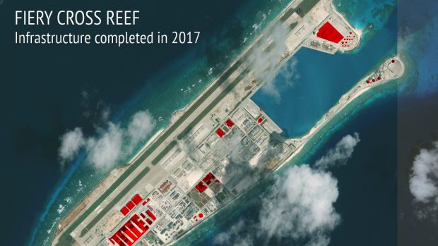 This image provided by CSIS Asia Maritime Transparency Initiative/DigitalGlobe shows a satellite image of Fiery Cross ...