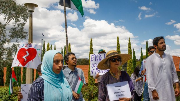 Community members from mixed faiths rally in front of the US embassy in Canberra to protest US President Donald Trump's ...