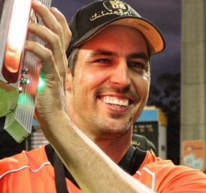 Reigning champs: Mitchell Johnson of the Scorchers carries the trophy after winning last season's BBL T20 final against ...