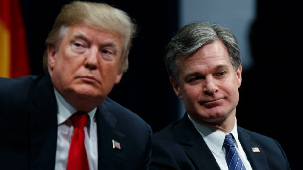 President Donald Trump sits with FBI Director Christopher Wray during the FBI National Academy graduation ceremony in ...