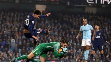 Manchester City goalkeeper Ederson collides with Tottenham Hotspur's Dele Alli during the English Premier League soccer ...