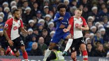 Chelsea's Willian, centre, competes for the ball with Southampton's James Ward-Prowse, right, as Southampton's Ryan ...