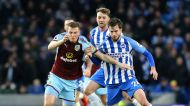 Burnley's Chris Wood, left and Brighton & Hove Albion's Davy Propper battle for the ball, during the English Premier ...