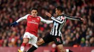 Arsenal's Alexis Sanchez, left and Newcastle United's Isaac Hayden battle for the ball, during the English Premier ...