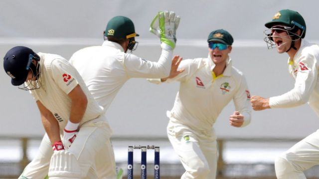 Dismissed: England captain Joe Root, left, after being caught by Australia's Steve Smith on day four at the WACA.