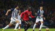 Manchester United's Romelu Lukaku, center, in action with West Bromwich Albion's Ahmed Hegazi during their English ...
