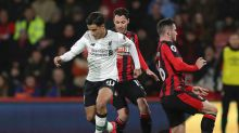 Liverpool's Philippe Coutinho, left, approaches the goal to score against Bournemouth during the English Premier League ...