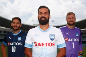 New look: Sydney FC captain Alex Brosque   and team mates Milos Ninkovic and Andrew Redmayne in the club's new strip for ...