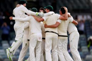 The Australians celebrate winning the Ashes at the WACA.