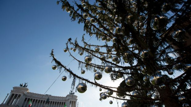 Despite the tree's 600 silver-coloured balls, the half-bare branches lend the square a forlorn rather than festive look.