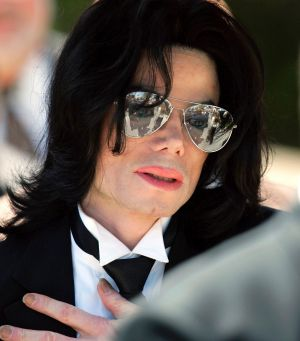 Michael Jackson gestures as he leaves court during his trial on child molestation charges in 2005.