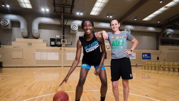 Canberra Capitals young gun Ezi Magbegor and Australian Opals Coach Sandy Brondello. Photo: Dion Georgopoulos