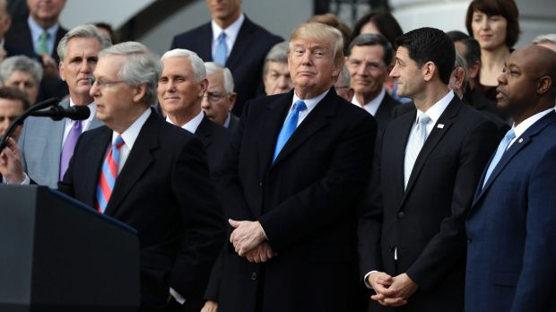 From left: Senate Majority leader Mitch McConnell heaps praise on Trump as Vice President Mike Pence, the President and ...