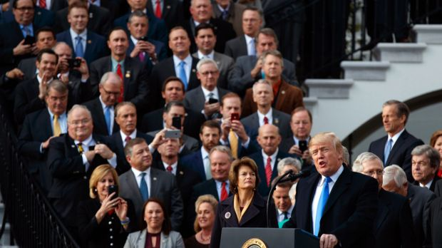 The fans: Republicans take their cameras out to record President Donald Trump celebrating the final passage of tax ...