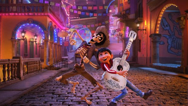 Hector, voiced by Gael Garcia Bernal, left, and Miguel, voiced by Anthony Gonzalez, perform in Coco.