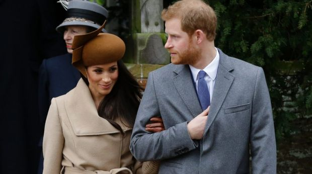 Meghan Markle and Prince Harry arrive for the royal family's traditional Christmas Day service at St Mary Magdalene ...