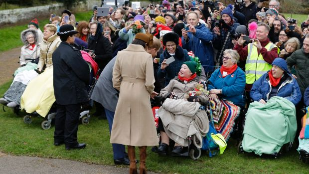 Meghan Markle and Prince Harry chat to well-wishers after the Christmas Day service at Sandringham.