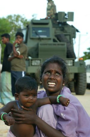 A Tamil woman and her daughter arrive at a camp for refugees fleeing internal violence in Sri Lanka. The conditions in ...