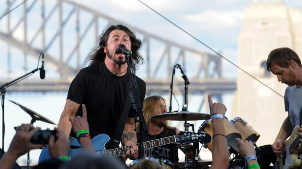 Dave Grohl (left), Taylor Hawkins (back) and Nate Mendel of the Foo Fighters perform on Goat Island in Sydney Harbour in ...
