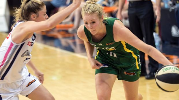 Ranger Kiera Rowe drives to the basket against Adelaide.
