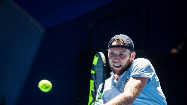 Opening victory: Jack Sock of the United States takes on Karen Khachanov.