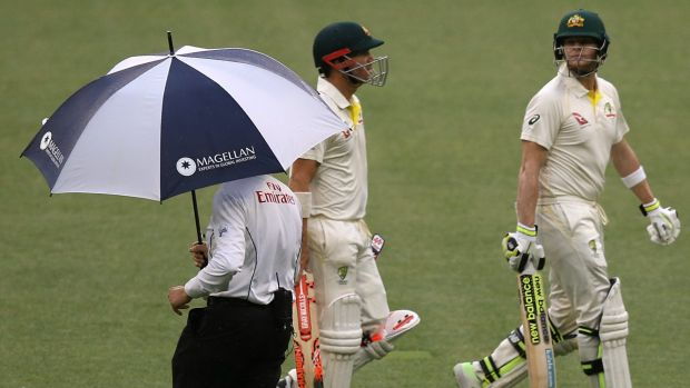 Downpour delight: Rain delayed play to make the draw an easier target for the Australians.