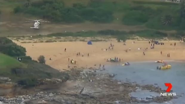 A fisherman is in a critical condition after being swept off rocks at Little Bay.