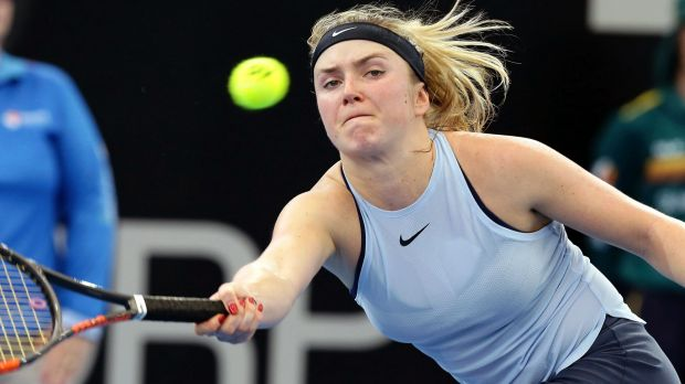 Stretched: Elina Svitolina of Ukraine reaches for a shot against Carla Suarez Navarro of Spain.