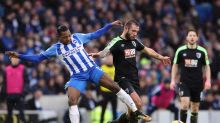 Brighton & Hove Albion's Jose Izquierdo, left, and AFC Bournemouth's Steve Cook battle for the ball during the English ...