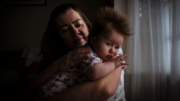 Kim Hutchinson with her three-month old baby Celia, who cries for hours with colic.