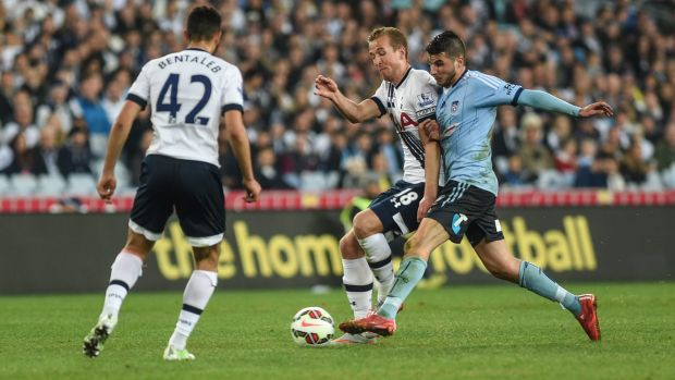 Back to Australia: Terry Antonis jostles for possession with Tottenham Hotspur's Harry Kane.