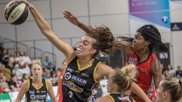 Boomer Louella Tomlinson controls a rebound in front of Perth's Amanda Dowe during their WNBL semi-final clash on ...