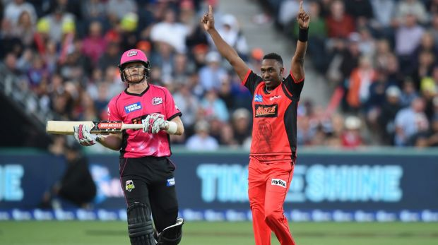Too good: Dwayne Bravo of the Renegades (right) celebrates the wicket of Sam Billings of the Sixers.