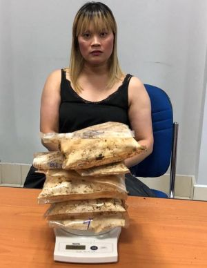 An Australian woman born in Vietnam has been arrested allegedly with 1.8 kilograms of heroin hidden in a suitcase case ...