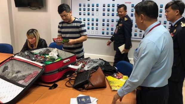 Australian Federal Police played a key role in the arrest of 39-year-old Ve Thi Tran, far left, on Saturday morning as ...