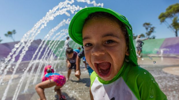 Families cool off at Blaxland Riverside Park in Parramatta as the mercury reaches into the 40s on Sydney's second ...